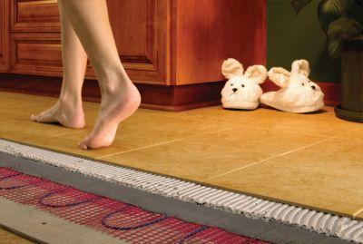 Водяной или электрический: способ организации «теплого пола» в доме